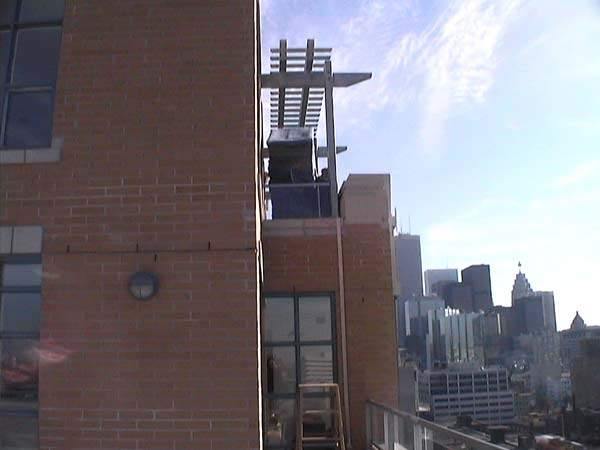 Hoisting-Armoir-Top-of-Building