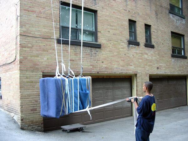 Hoisting-Large-Armoir