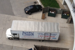 Hoisting-Sofa-10-stories-top-view-of-truck