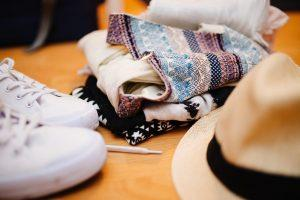 Some clothes, a hat and white trainers.