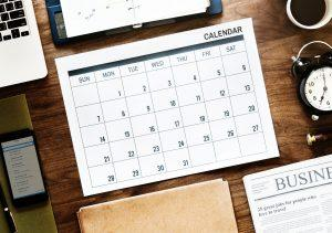 A calendar on the table. Starting your search a couple of months before the moving date is the best way to find affordable movers in Toronto.