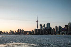A photo of some landmarks in Toronto in the early evening.
