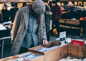 a man shopping on a yard sale