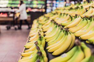 A close up of bananas in a supermarket.