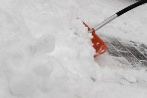 cleaning snow with a showel