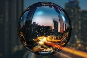 A street in Toronto during the night seen through a globe made of glass.