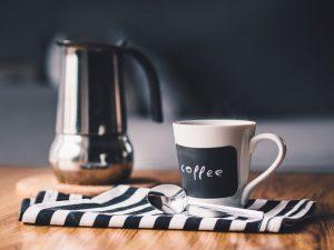 A mug and a pot of coffee.
