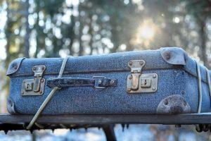 A blue suitcase.