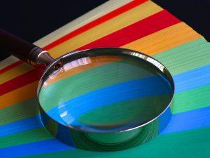 A magnifying glass to look at the process of how to prepare a car for shipping.