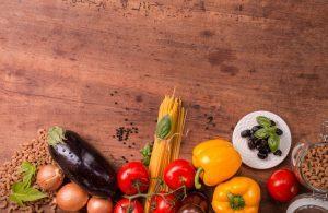 Food on a table (tomatoes, eggplant, paprika)