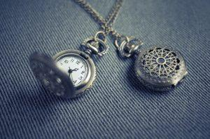 Two antique-looking pocket watches.
