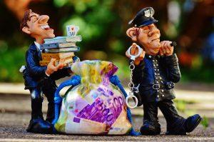 Two figurines of a police officer and a businessman.