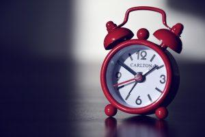 A red alarm clock.