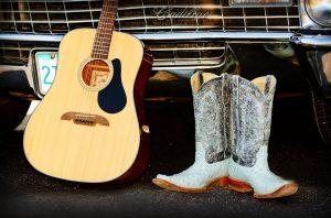 A guitar and cowboy boots.