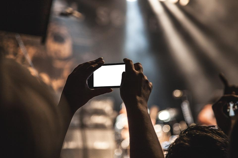 A person taking a picture in one of live music venues in Toronto.