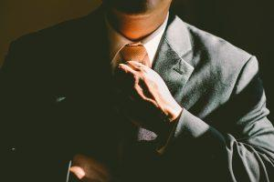 A person in a business suit.
